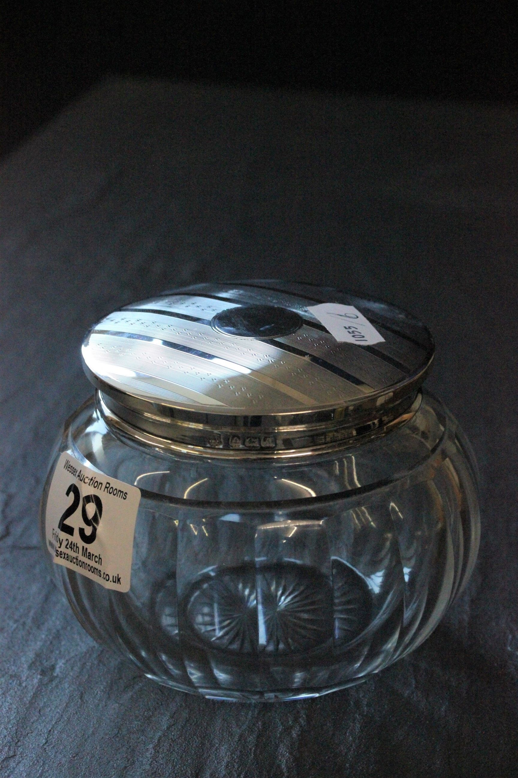 Lot 29 - A silver topped glass toilet jar with engine turned cover and vacant cartouche, London 1926