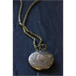 Lot 60 - Small gold locket on yellow metal chain
