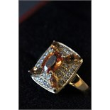 Lot 40 - 14ct Yellow gold citrine and diamond cross over ring