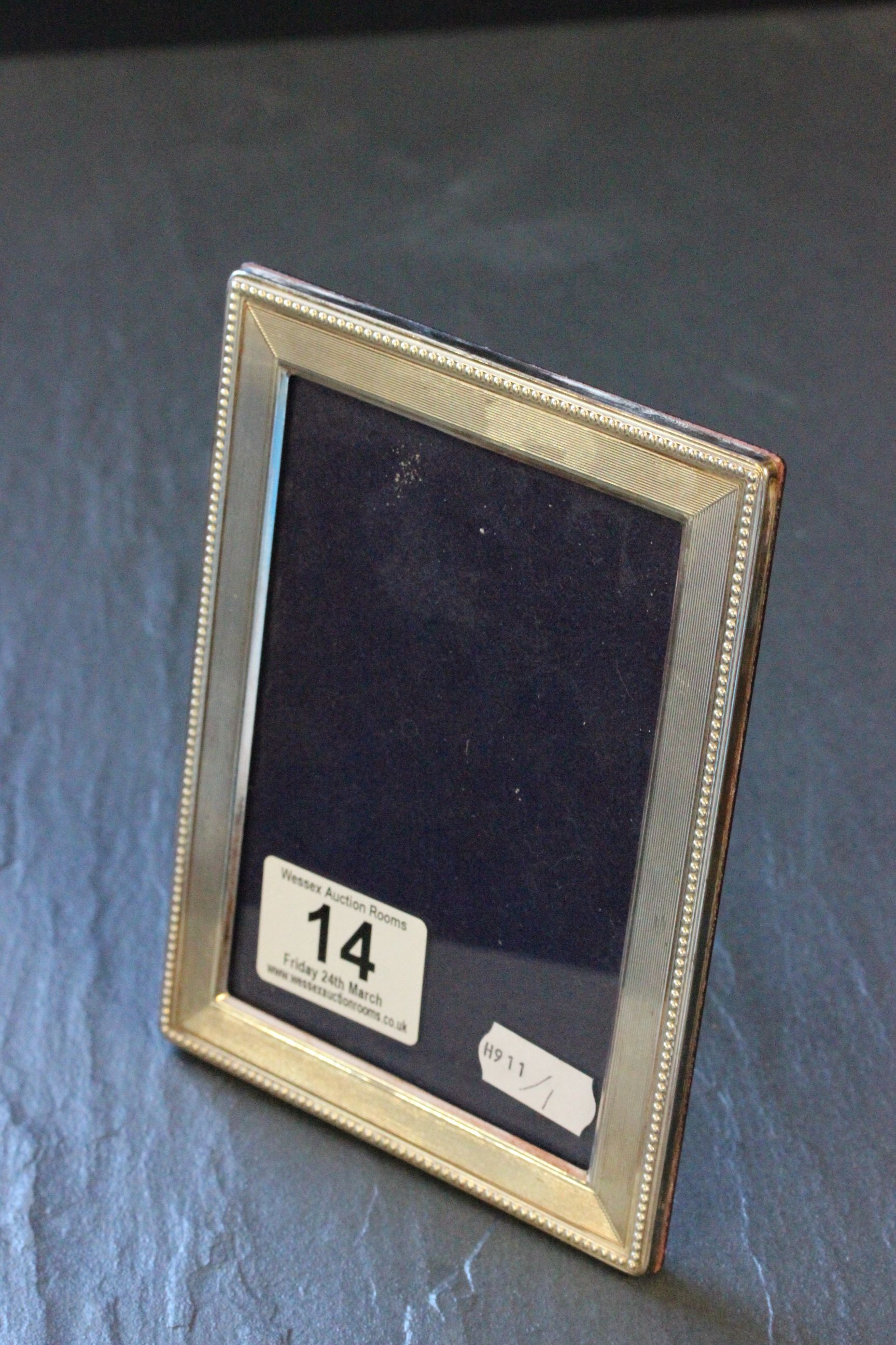 Lot 14 - A modern silver photograph frame with beaded border, with London silver import marks