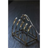 Lot 30 - A four section silver toast rack, Chester hallmarks