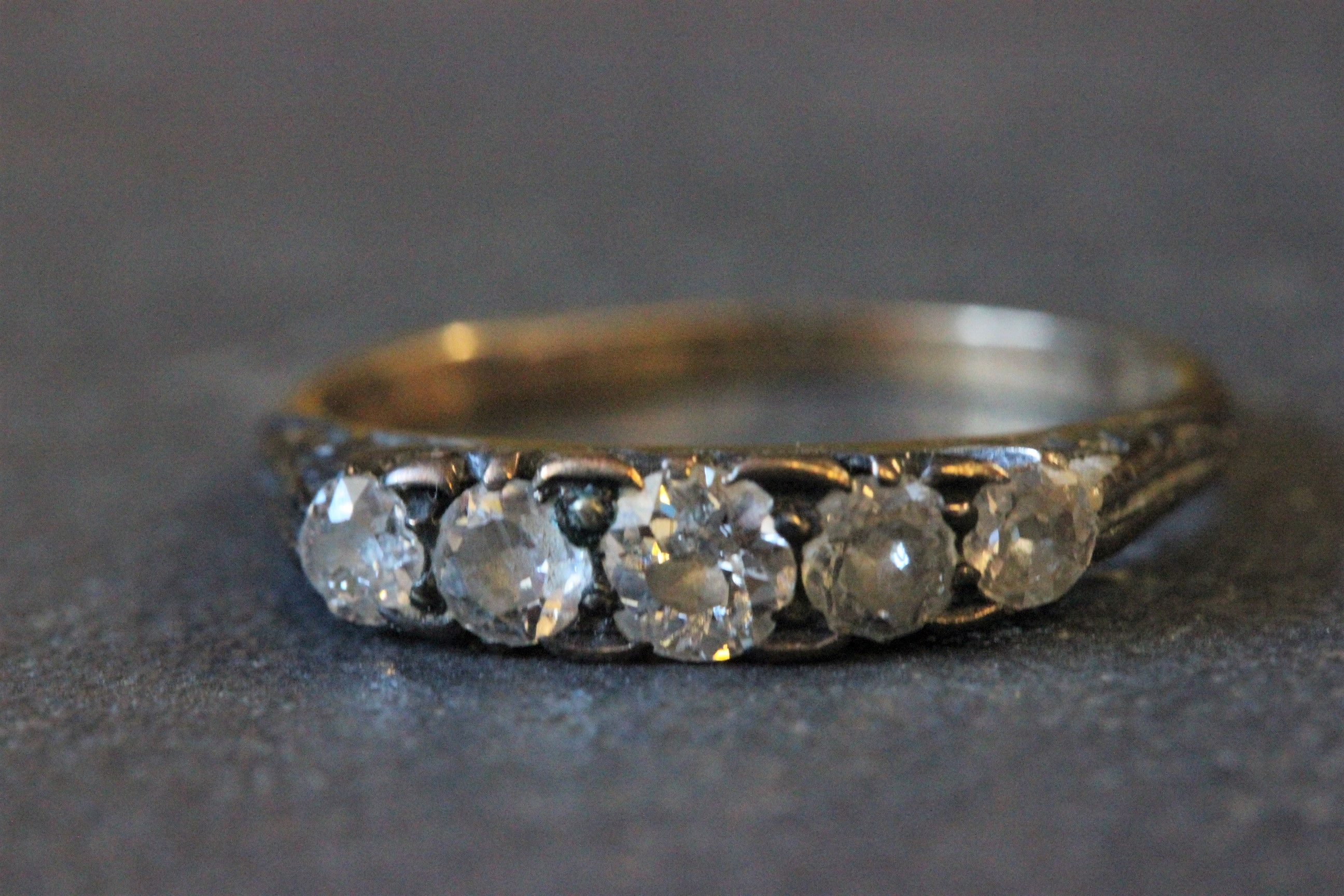 Lot 19 - Yellow metal four stone diamond ring