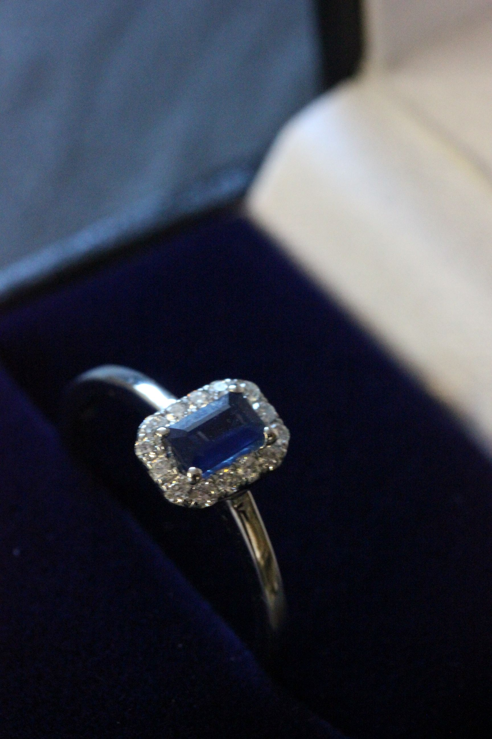 Lot 56 - 9ct White gold sapphire and diamond ring