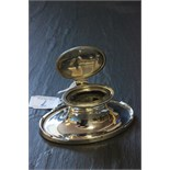 Lot 7 - A 20th century oval silver capstan inkwell with glass insert, Birmingham, 1924, A & J Zimmerman