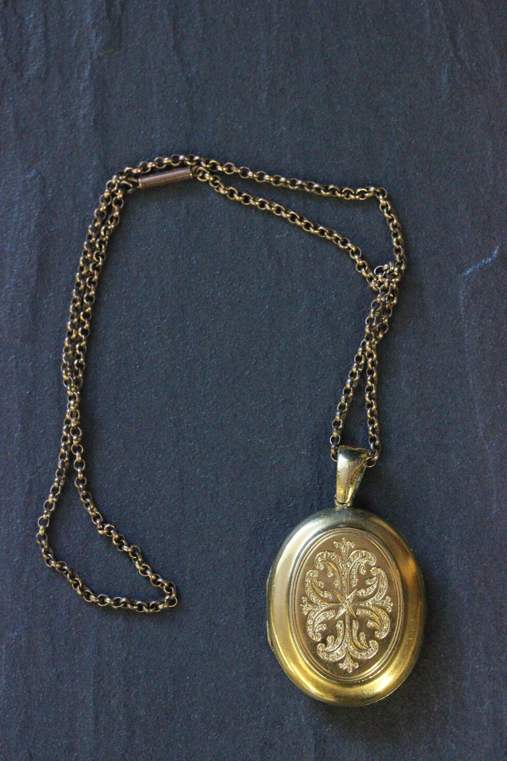 Lot 46 - Large gold locket on 9ct gold chain