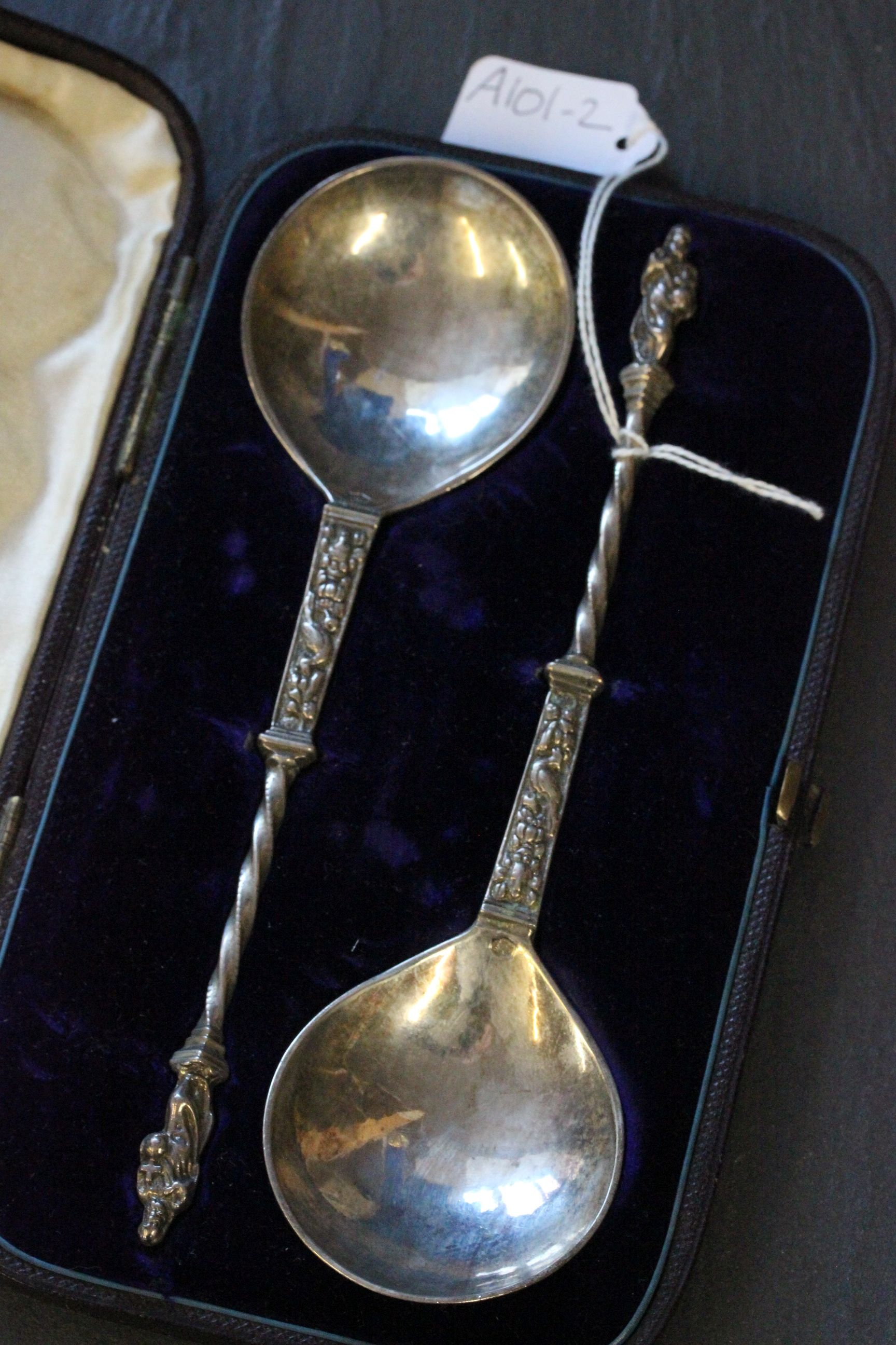 Lot 58 - Large pair of cased Continental silver Apostle style spoons with London retailer to the box