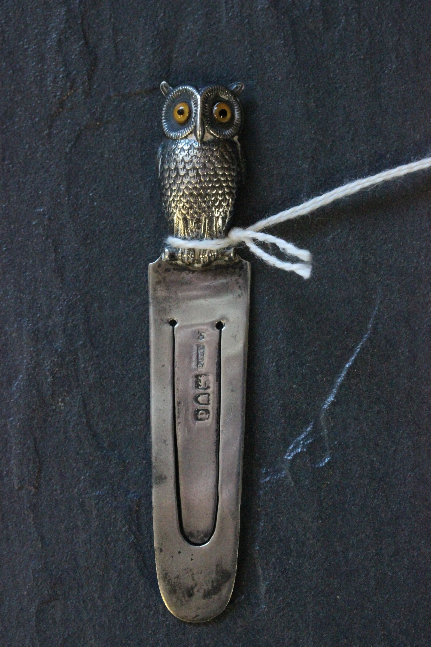 Lot 17 - A silver book mark with owl finial set with glass eyes, London 1900, Samson & Mordan