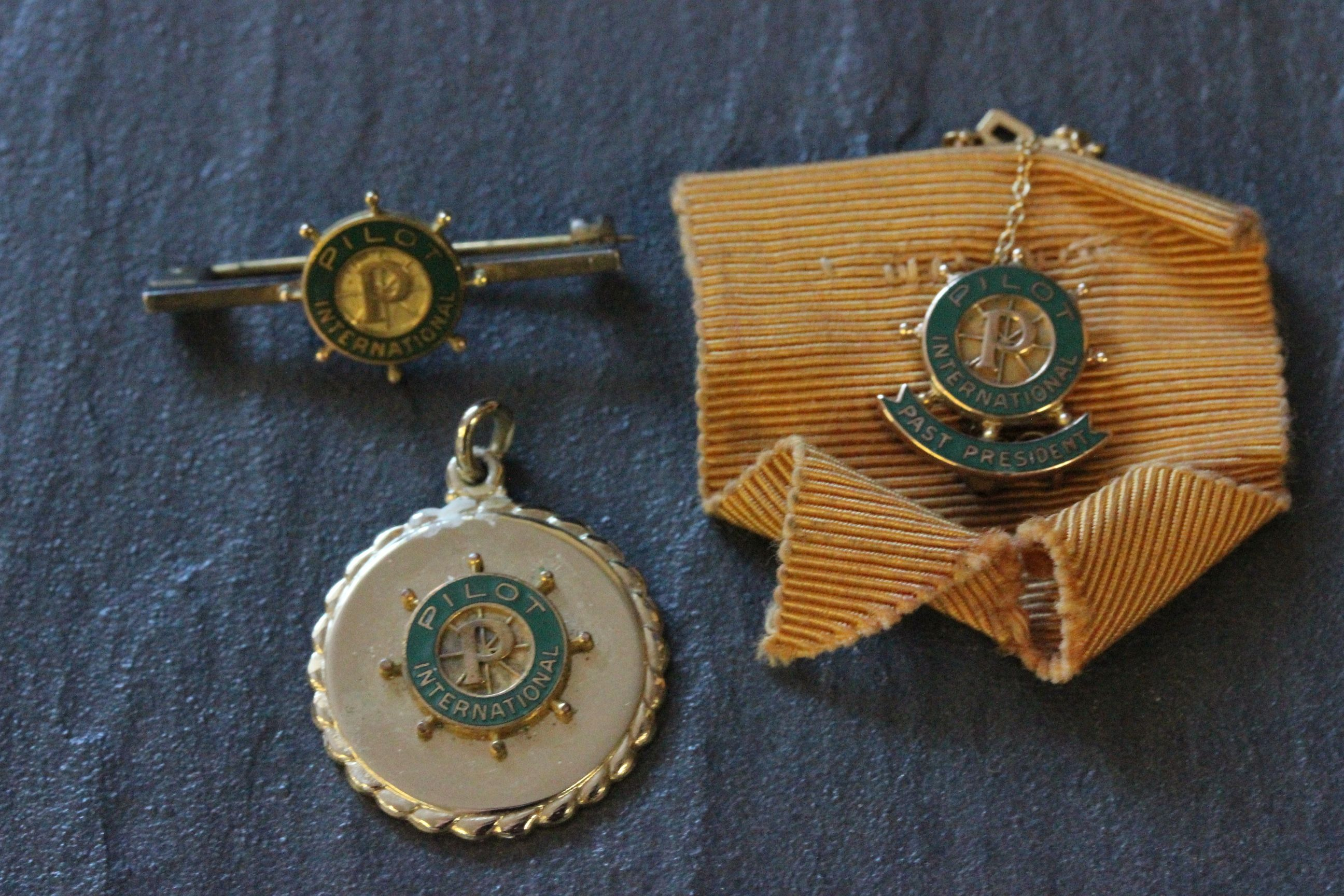 Lot 31 - Three Pilot International badges including 10k gold & enamel