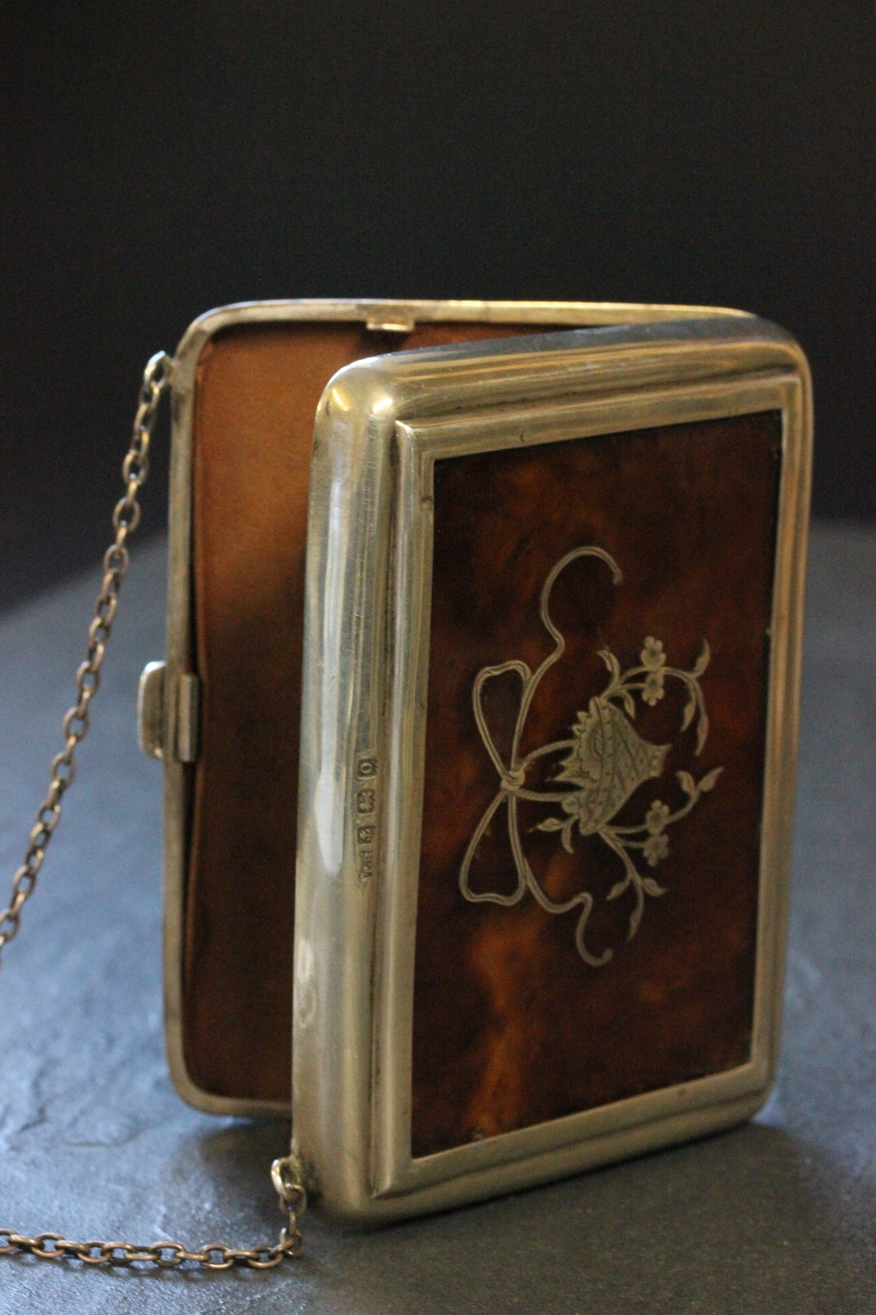 Lot 54 - A silver and tortoiseshell purse, with inlaid decoration of basket of flowers, Birmingham 1938 ,