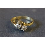 Lot 4 - 18ct Gold engagement ring with two diamonds