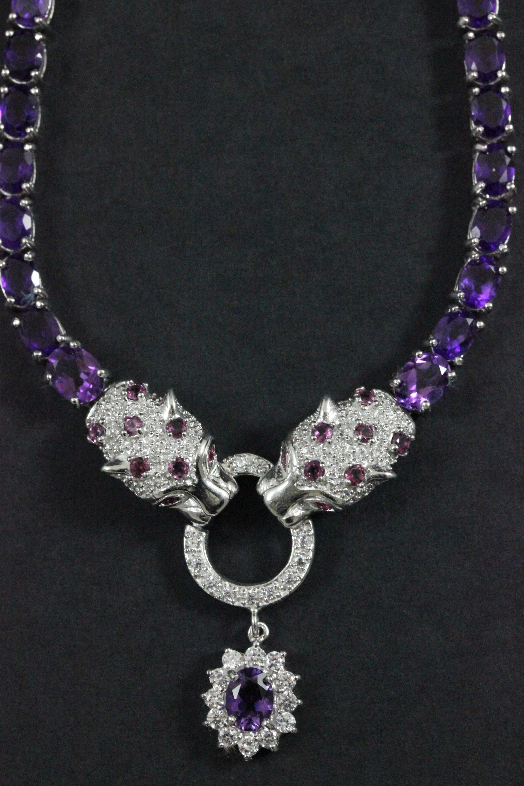 Lot 38 - Silver CZ and Amethyst Cartier style pendant necklace in the form of two panthers