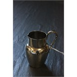 Lot 35 - A small silver milk/cream jug, London 1888