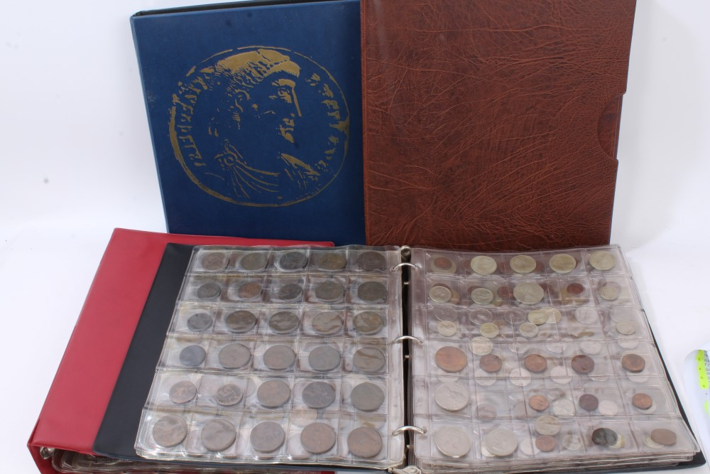 Lot 33 - World - a large accumulation of coinage within five coin albums - to include silver, cupro-nickel,