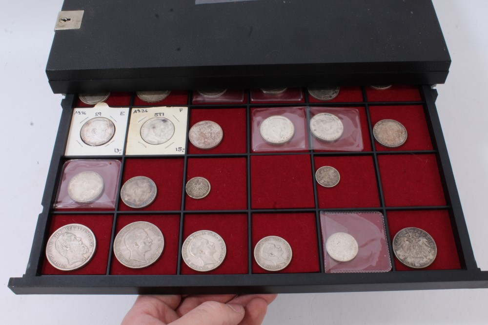 Lot 34 - World - a ten-drawer coin cabinet containing a quantity of silver, India Rupees, German 5 Marks,