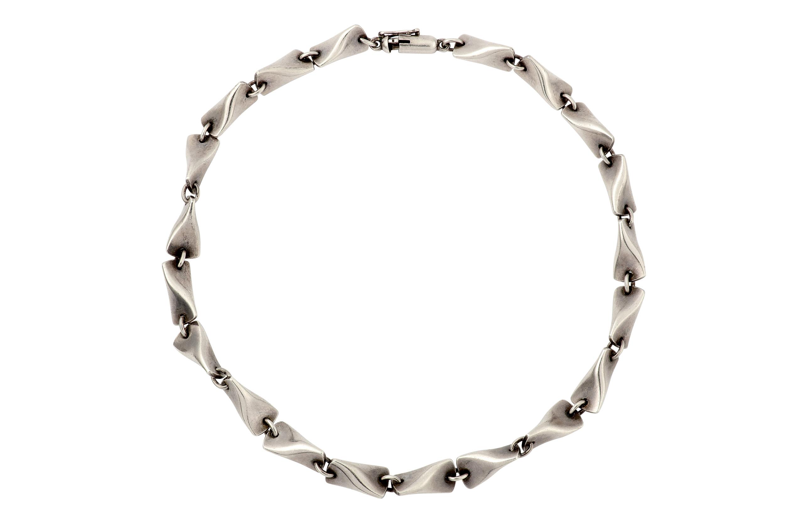 Lot 55 - A necklace and bracelet suite, by Kindt Larsen forGeorg Jensen, circa 1950
