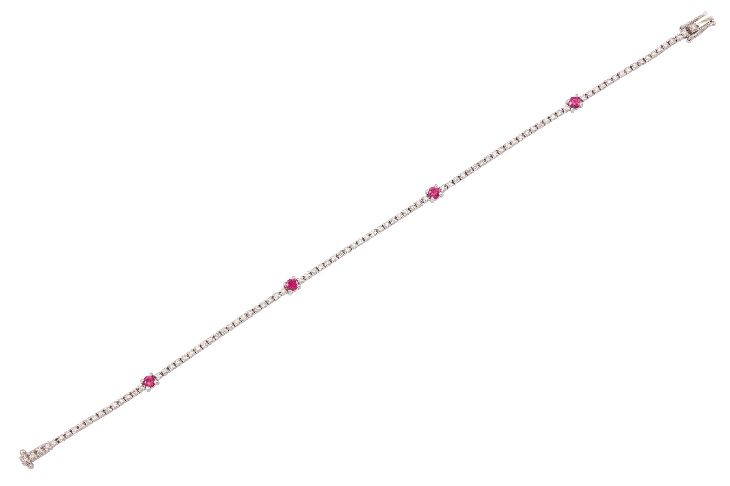 Lot 45 - A ruby and diamond line bracelet