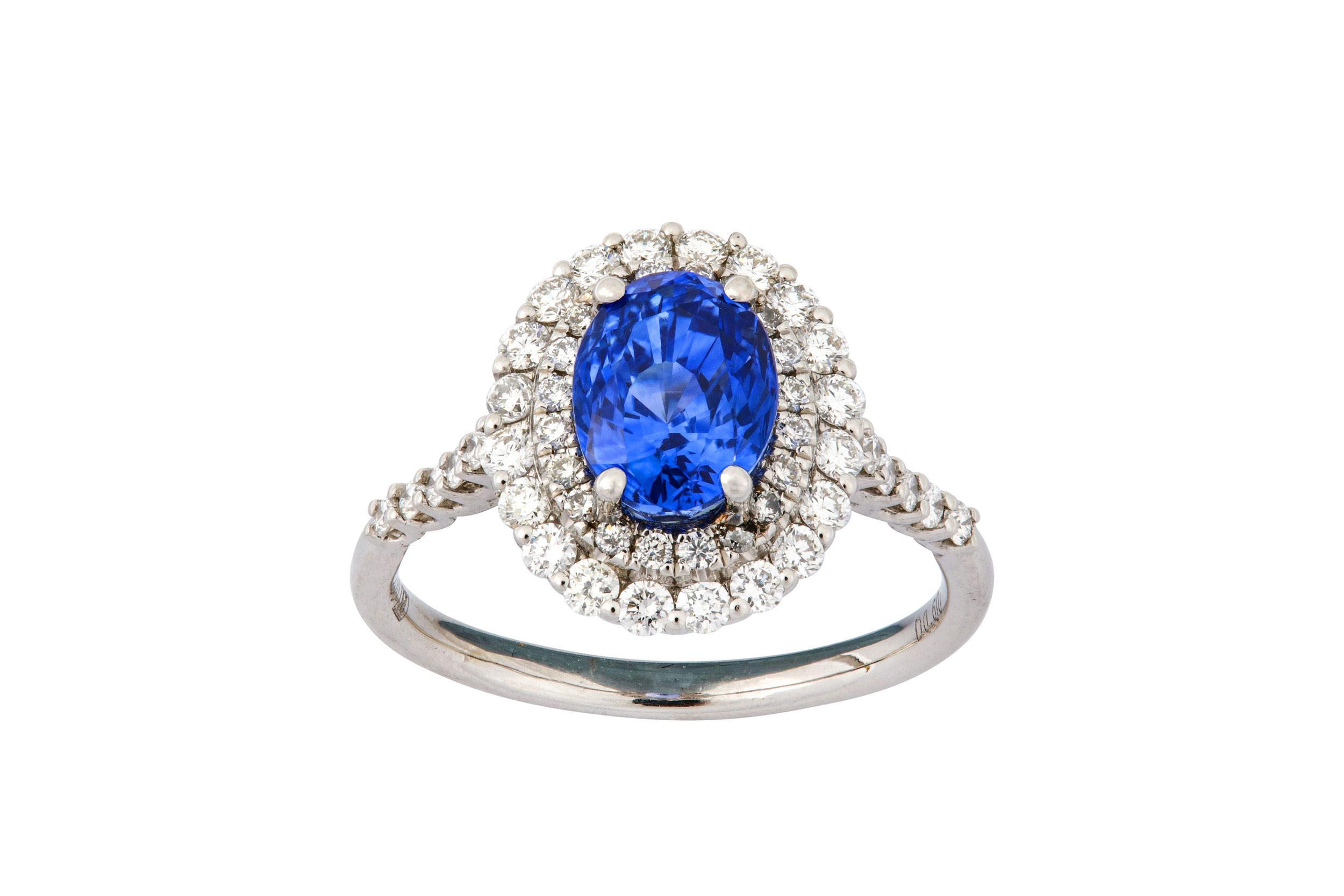 Lot 26 - A sapphire and diamond cluster ring