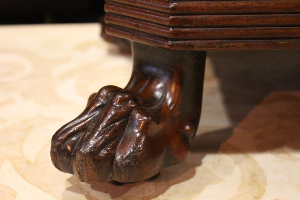 Lot 23 - A FINE IRISH GEORGIAN MAHOGANY WINE COOLER / CELLARET raised on lion paw feet, original gilded