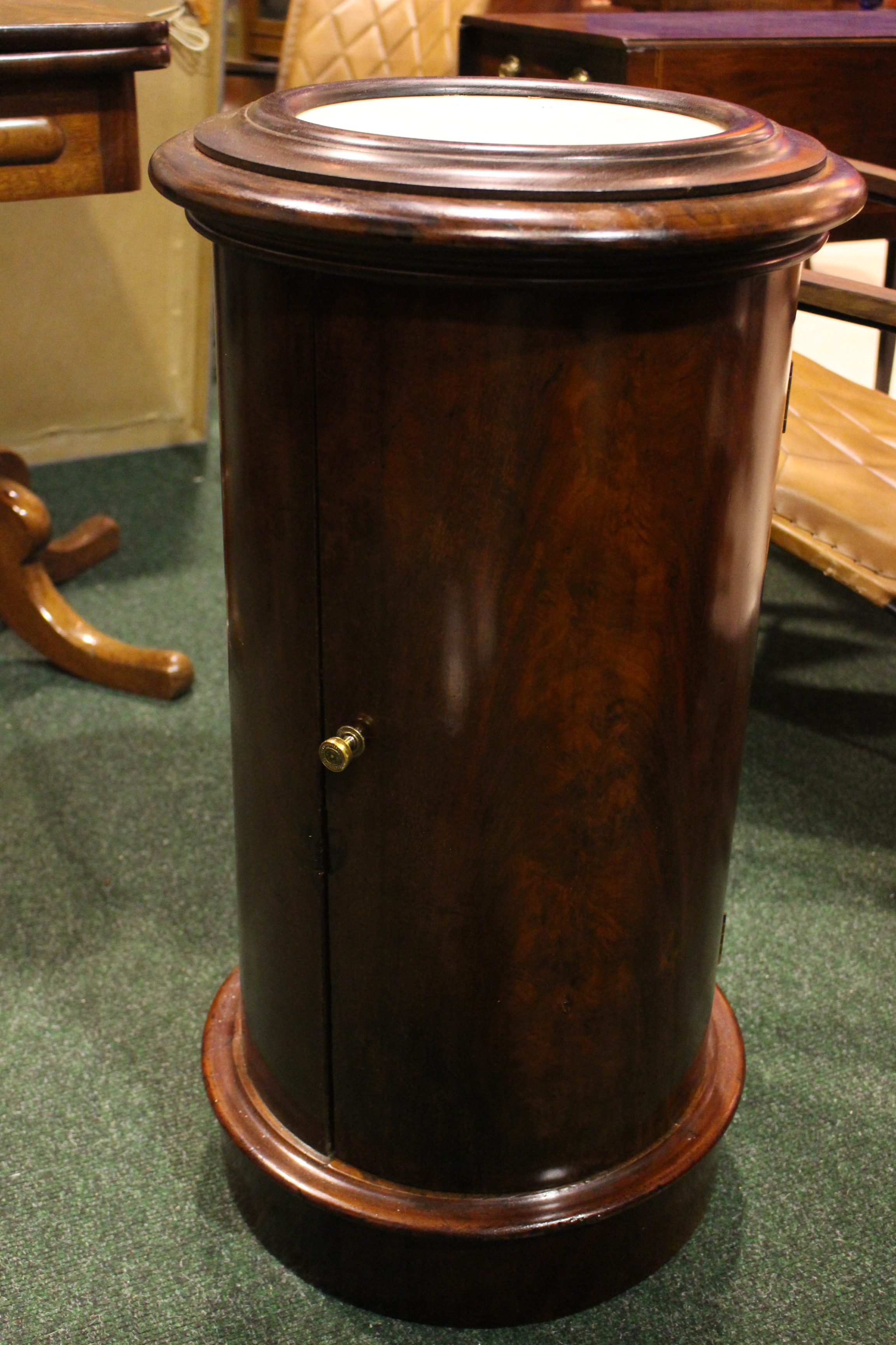 Lot 47 - A LATE 19TH CENTURY CYLINDRICAL CABINET, with hinged marble top, a curved single door to the body