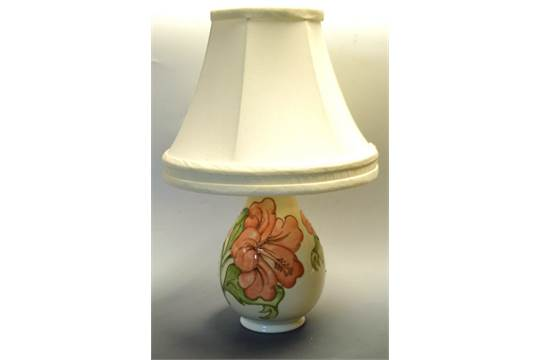 A Moorcroft Hibiscus pattern table lamp, tubelined with