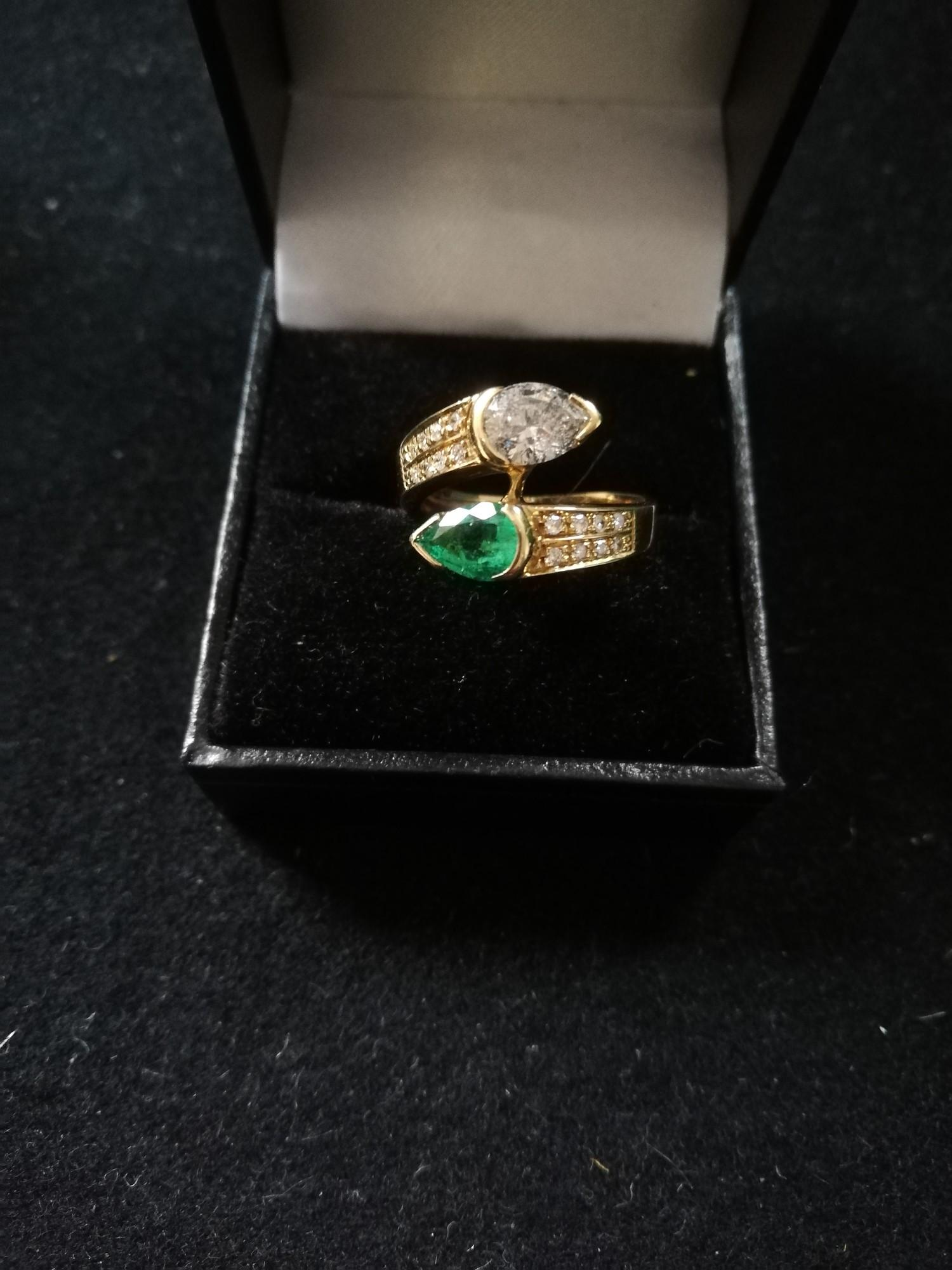 Emerald and Diamond pear shaped stones crossover ring