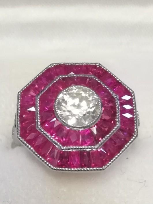 Fine quality octagonal shaped platinum ruby & diamond dress ring set with a central old cut diamond