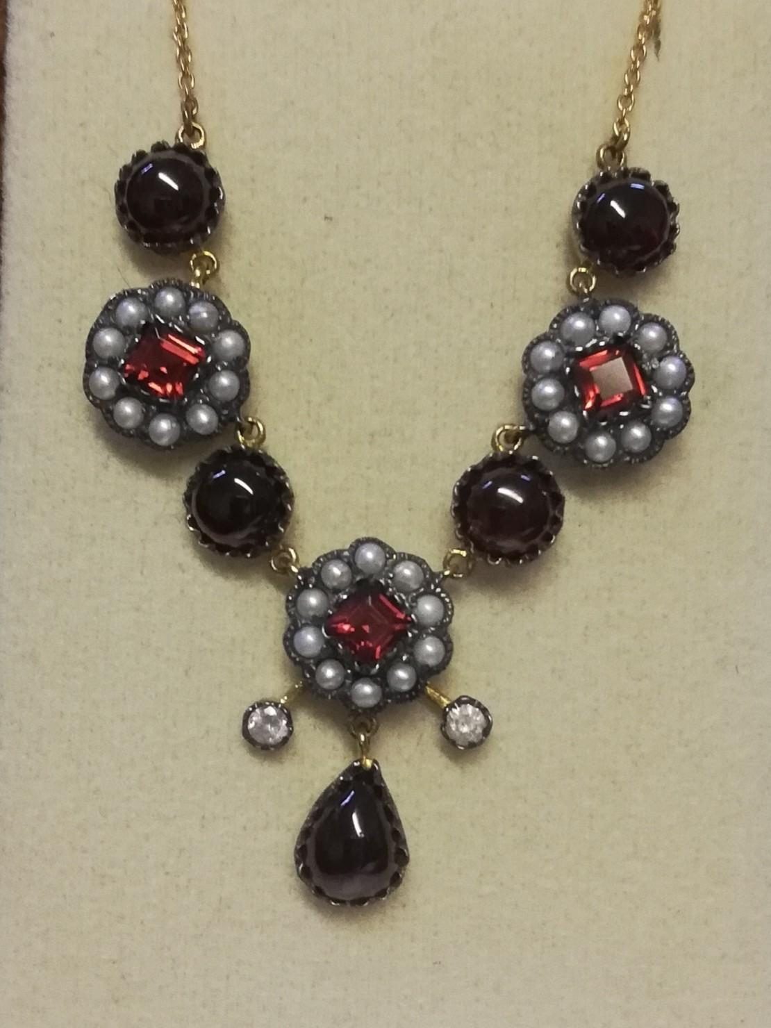"Necklace (18"") set with cabochon garnets, square cut garnets, seed pearls & diamonds"