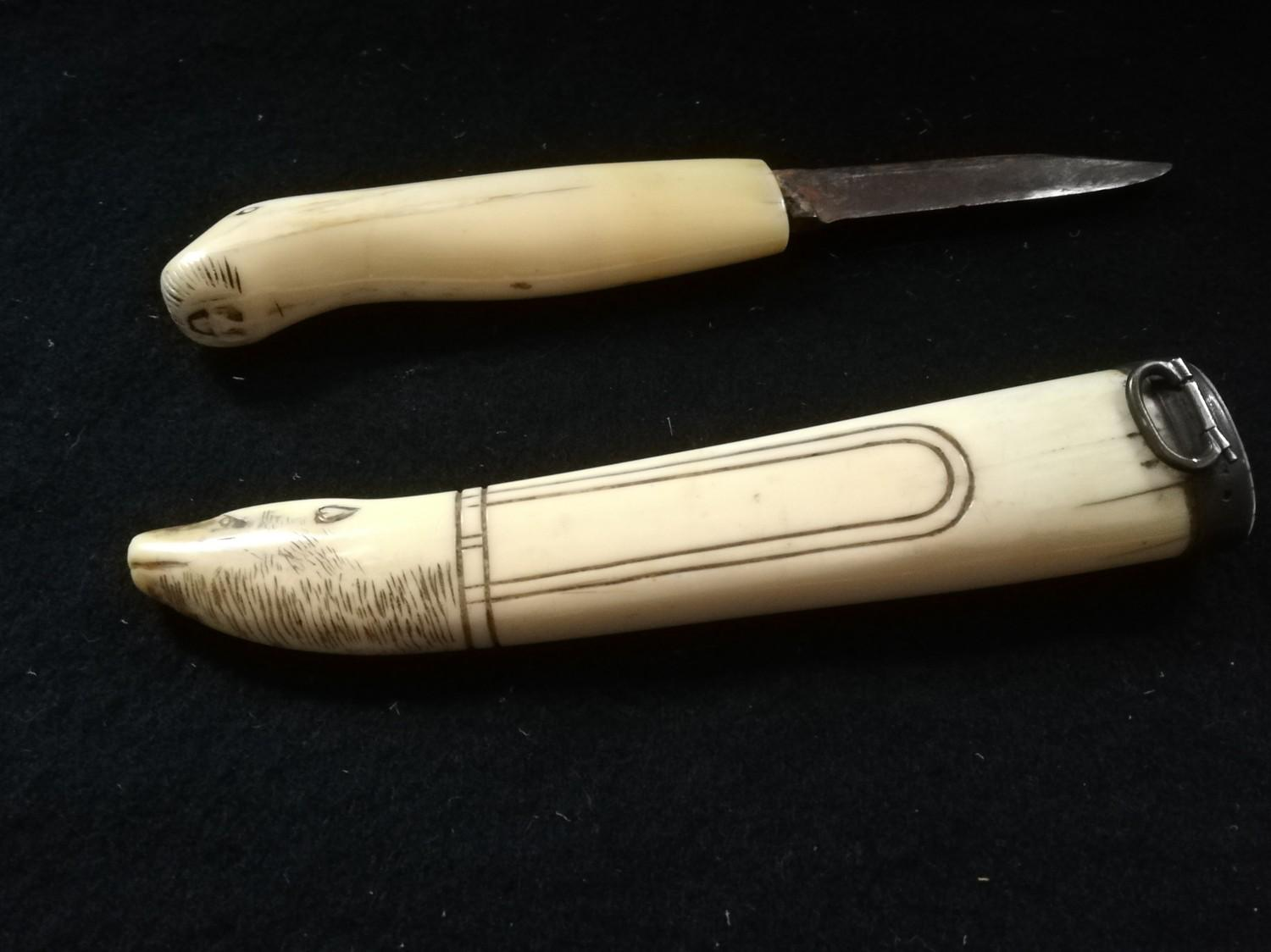 Lot 243 - Inuit bone handled knife with a primitively carved seal head pommel