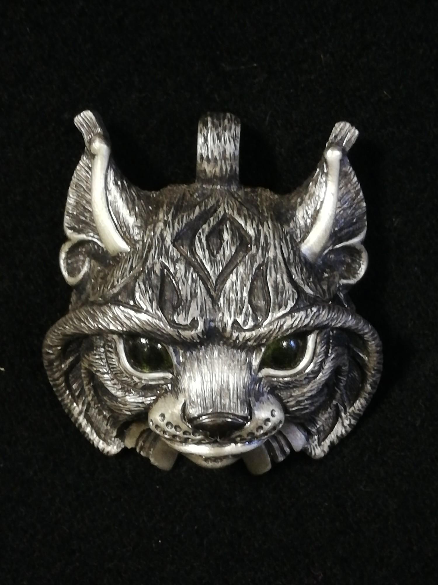Argent Aqua Jewellery by Adrian Ashley unusual silver lynx pendant set with peridot eyes