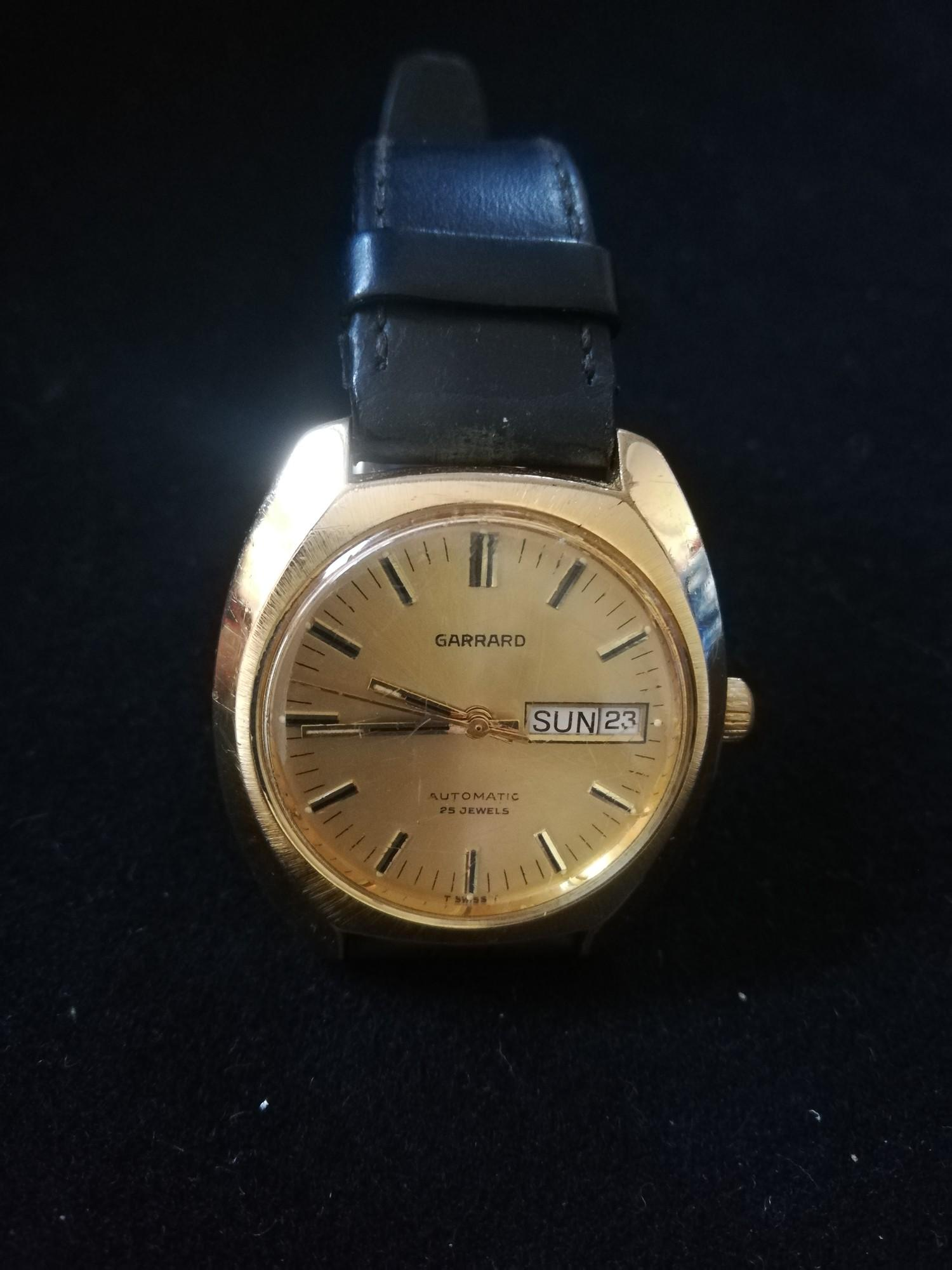 Garrard gold plated wristwatch with automatic movement in worn condition with inscription to back