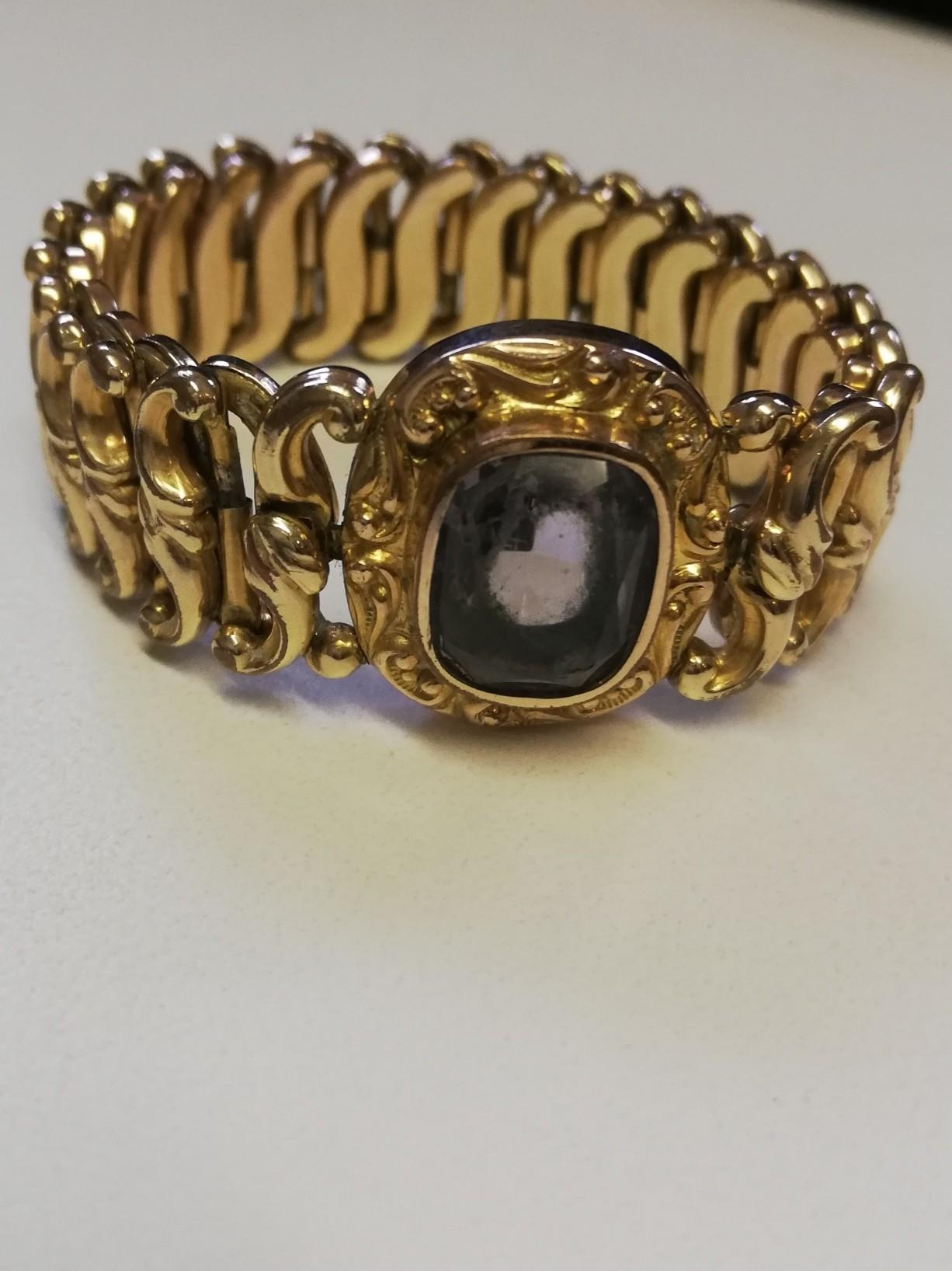 Minerva rolled gold expanding bracelet with amethyst central stone