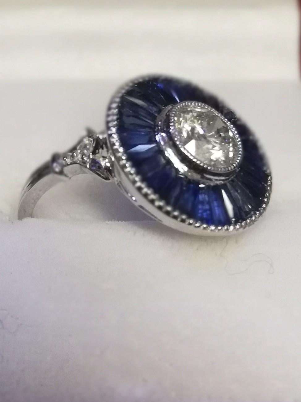 Large platinum target style ring set with central diamond and calibre cut sapphires - Image 3 of 3