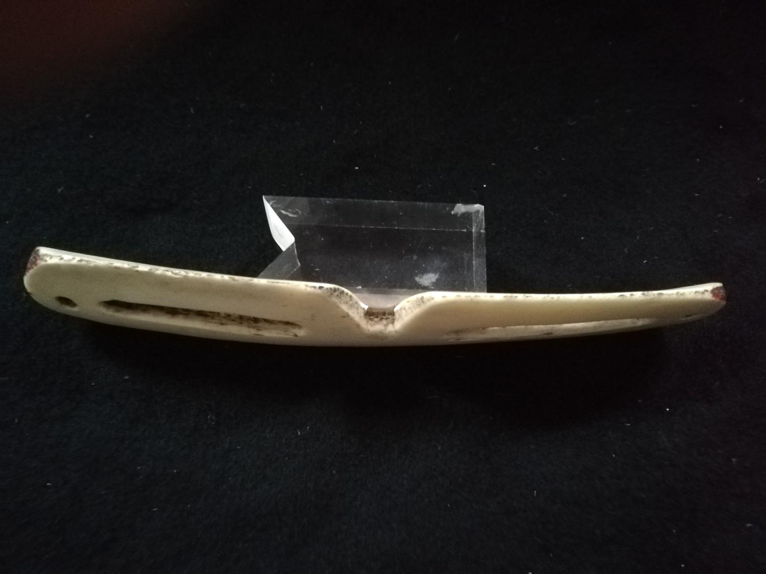 "Lot 241 - Inuit pair of snow goggles carved from bone -7"" long"