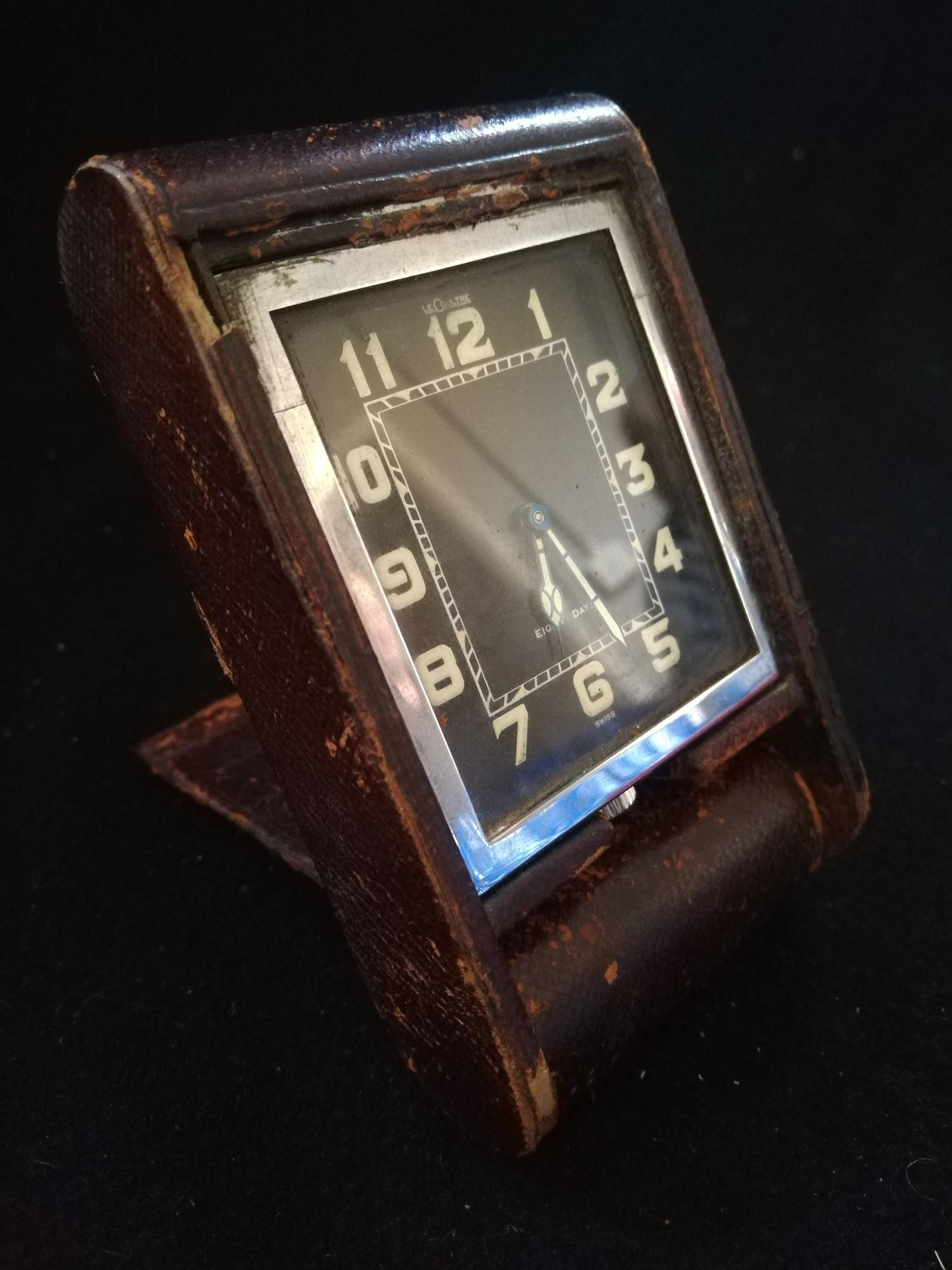 Le Coultre leather cased 8 day travel clock in worn condition & in running order
