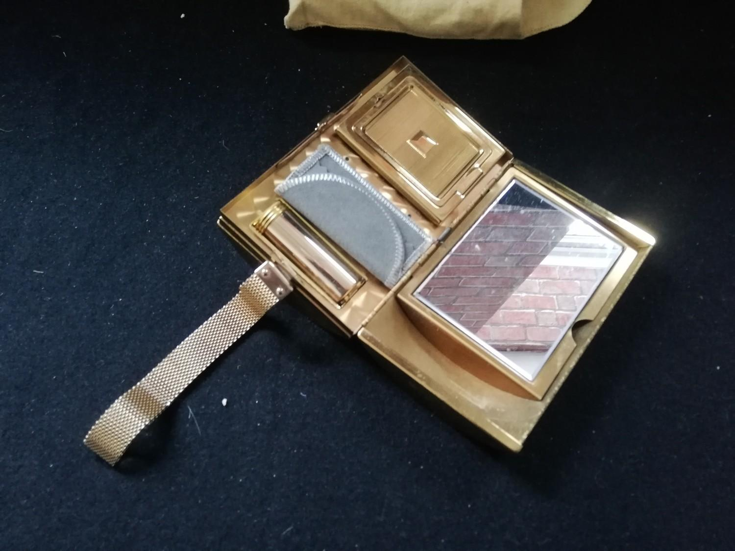 """Lot 128 - 1940's vanity case - cylindrical 2 parts with mesh wrist handle 5"""" x 3"""""""