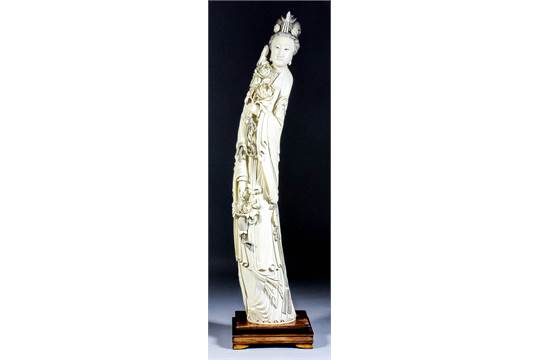 A large Chinese carved ivory tusk carving of Guan Yin