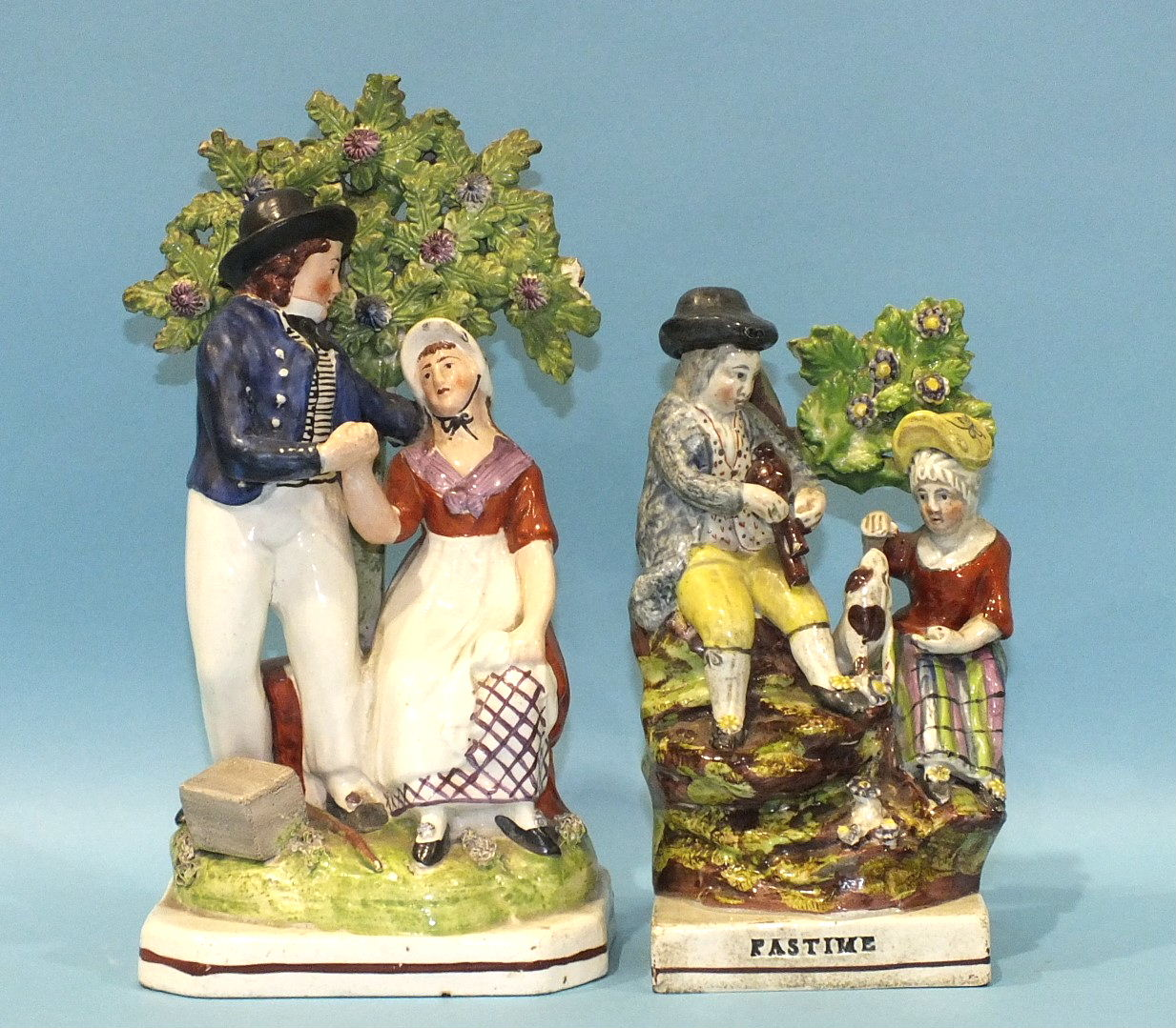 Lot 140 - An early-19th century Staffordshire pearlware group Pastime and a similar group The Sailor's Return,