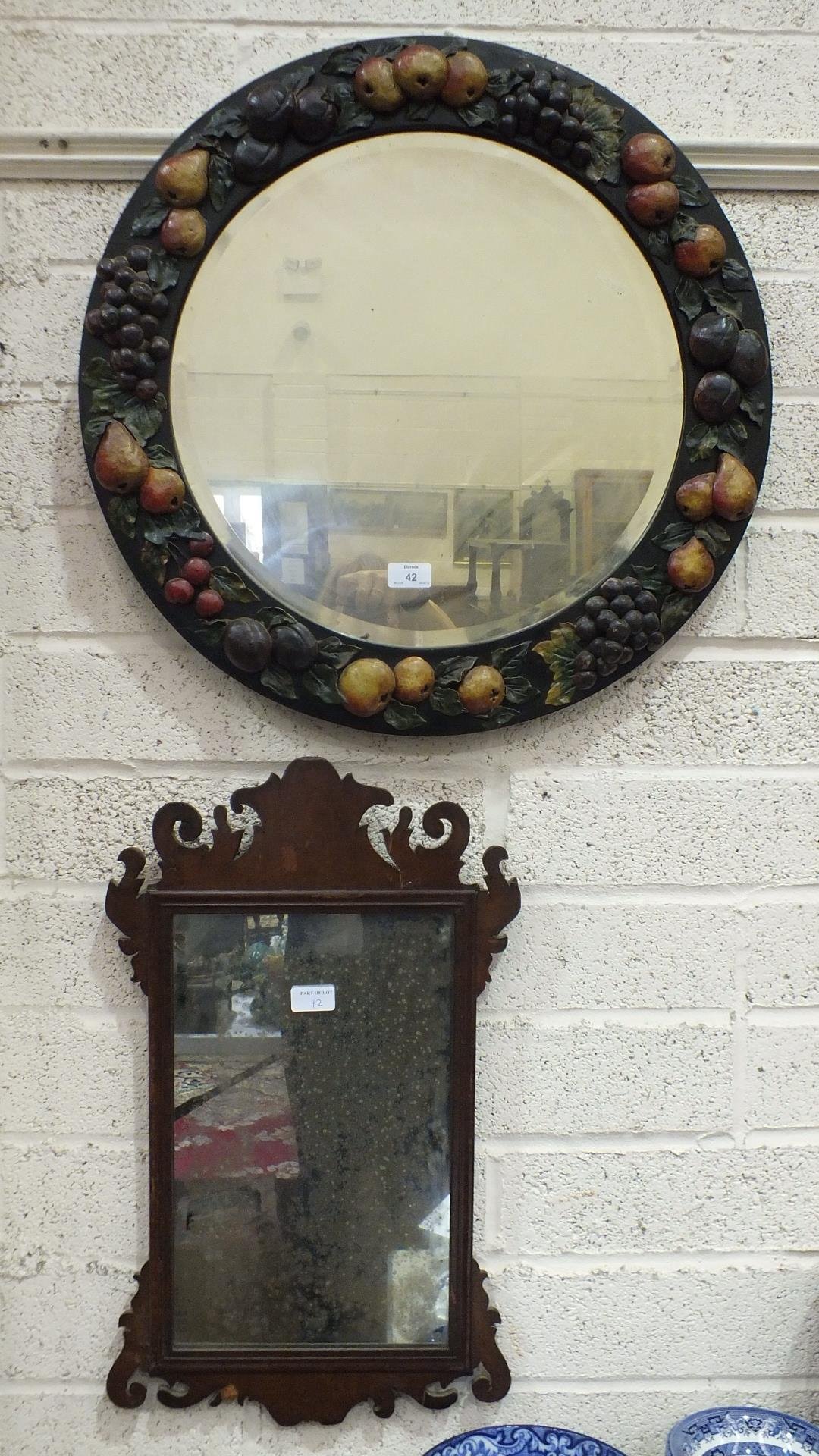 Lot 42 - A barbola work wall mirror, the circular plate within a frame applied with fruit, and three other