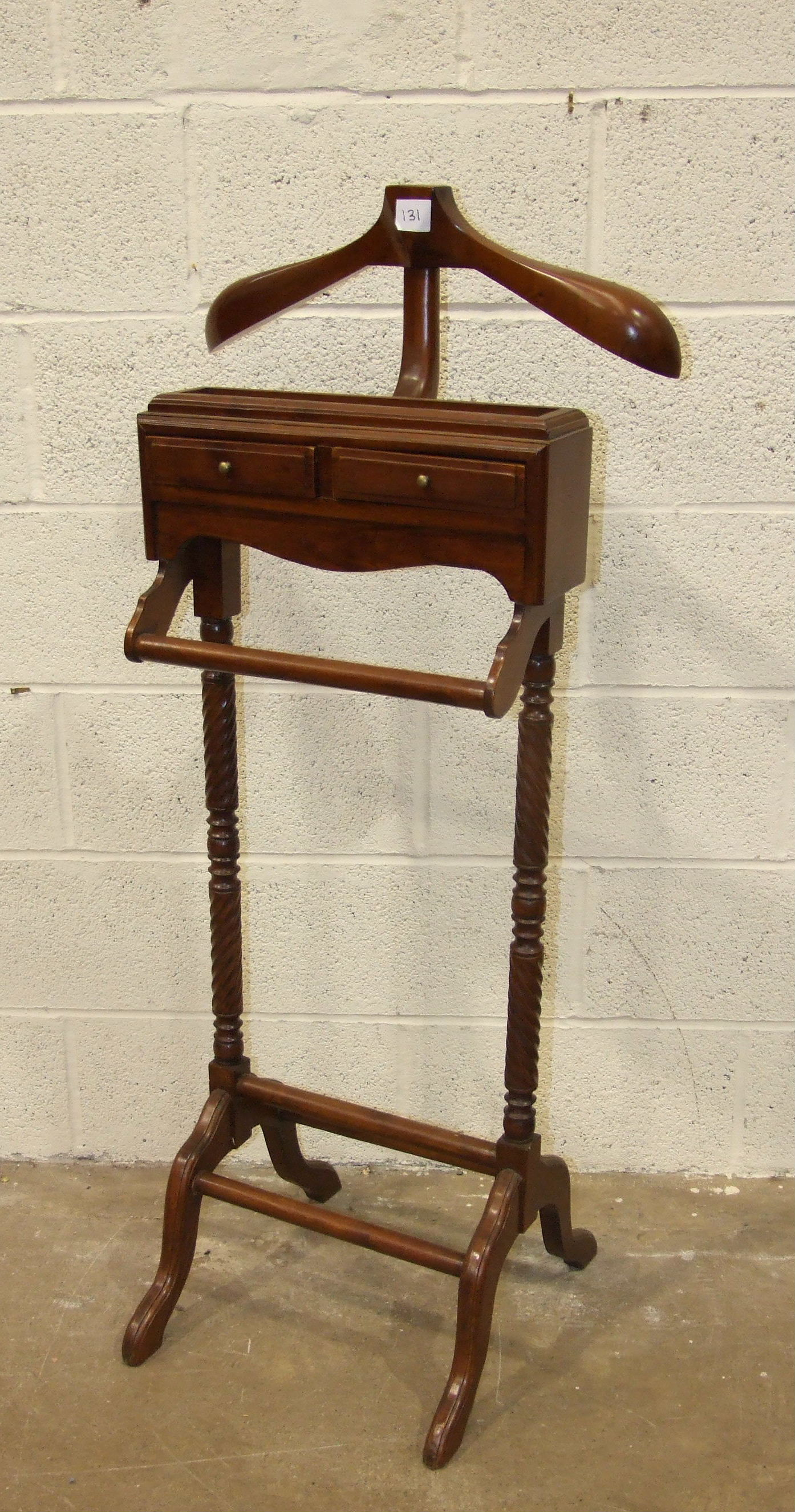 Lot 8 - A reproduction mahogany valet stand on twist supports, 128cm high.