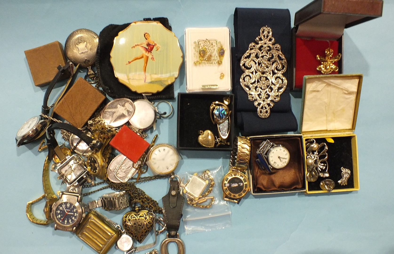 Lot 188 - A nurse's silver belt buckle, London 1979, and a quantity of watches and costume jewellery.