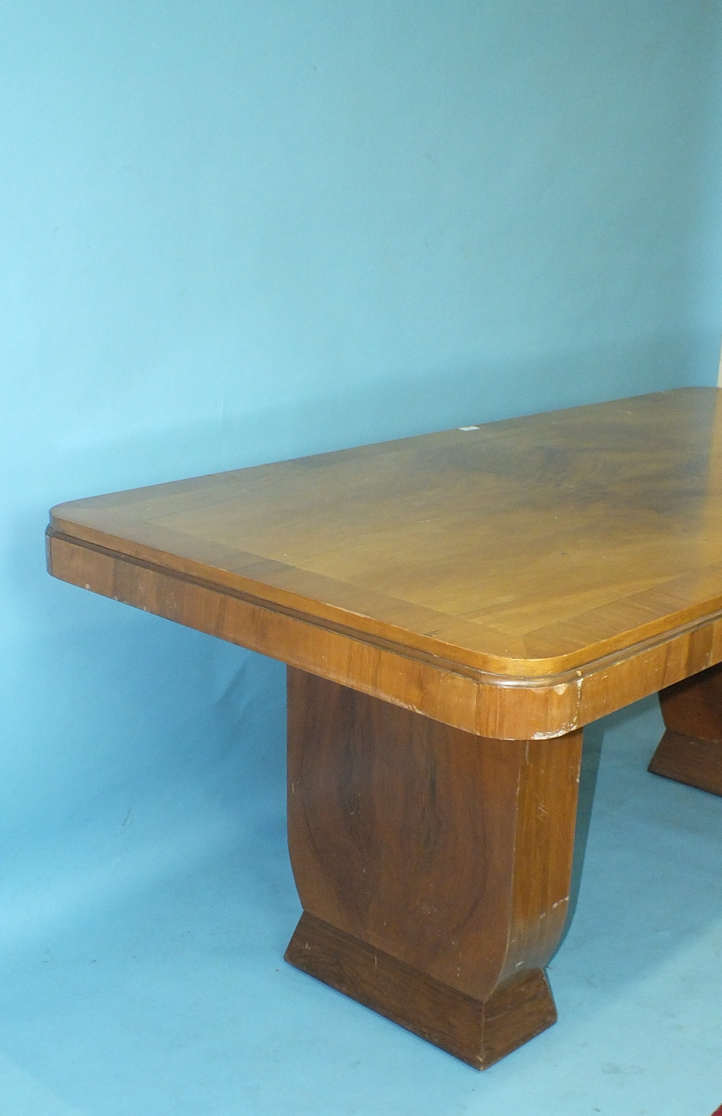 Lot 25 - A 1930's walnut-veneered dining table, 185 x 90cm and four chairs of rounded tub shape.