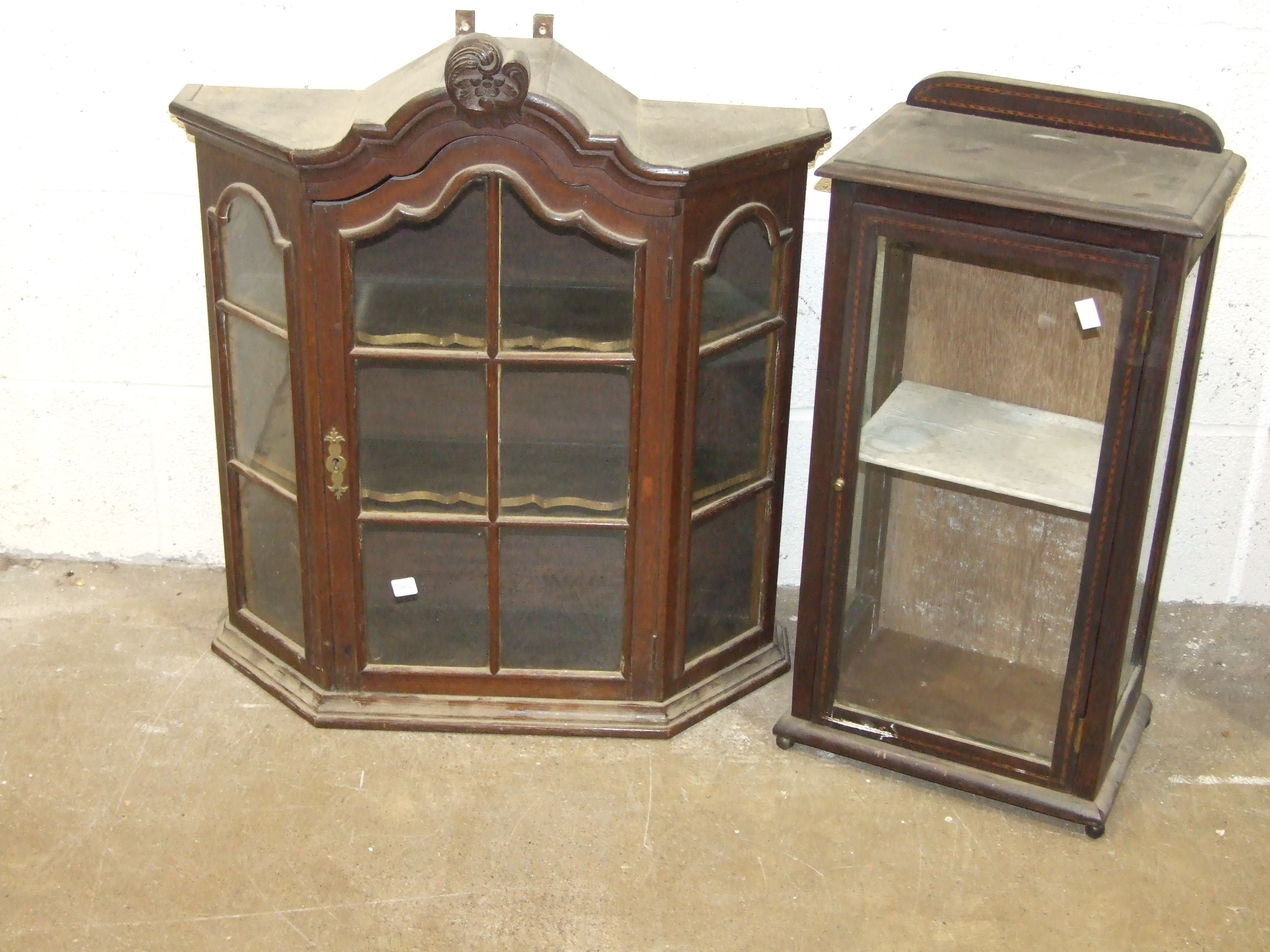Lot 34 - A small glazed oak wall cabinet in the Dutch style, 64cm wide, 73cm high and an Edwardian small