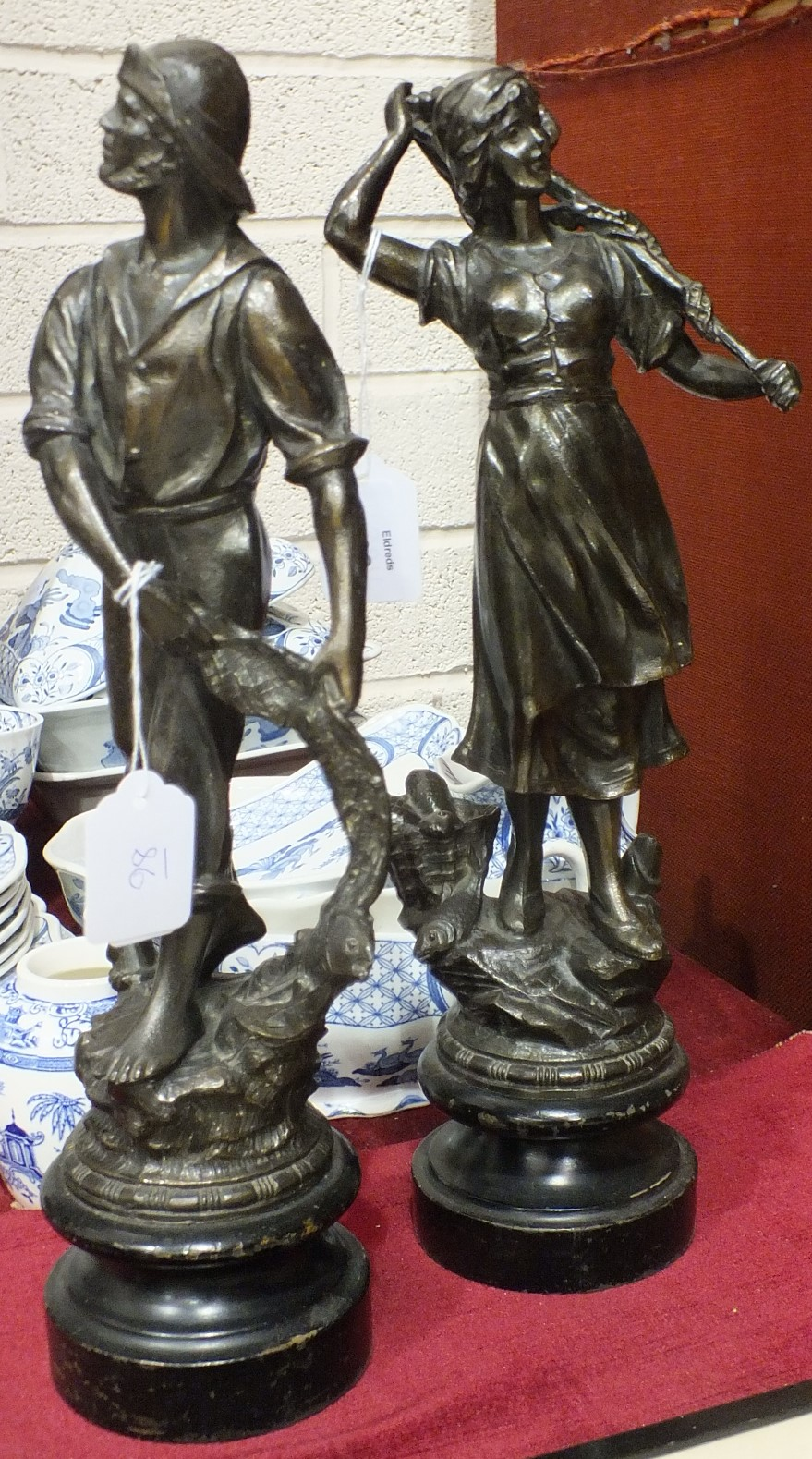 Lot 98 - A pair of spelter figures of a fisherman and woman, 39cm.