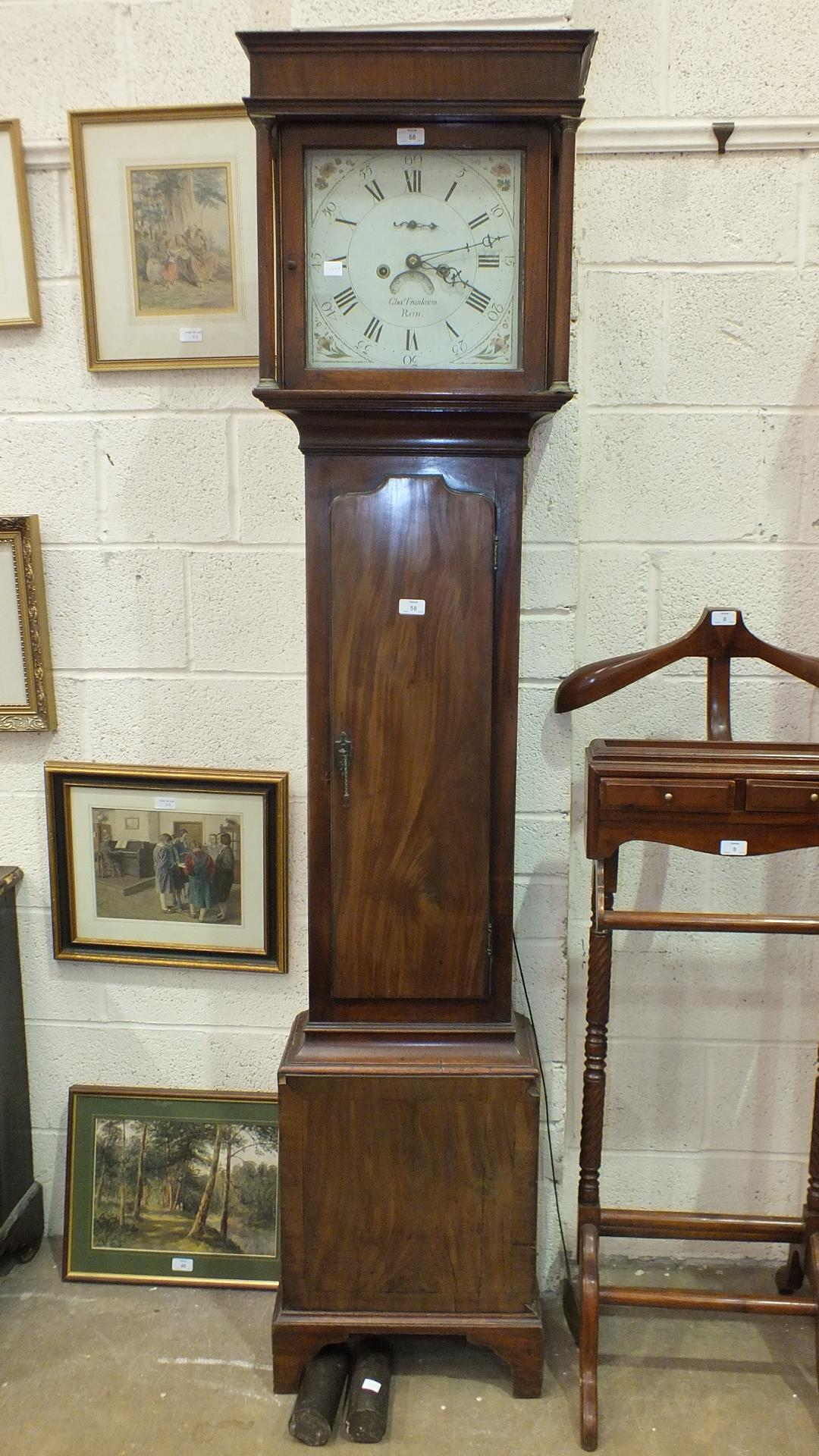 Lot 58 - A 19th century mahogany long case clock, the painted dial with calendar aperture and seconds