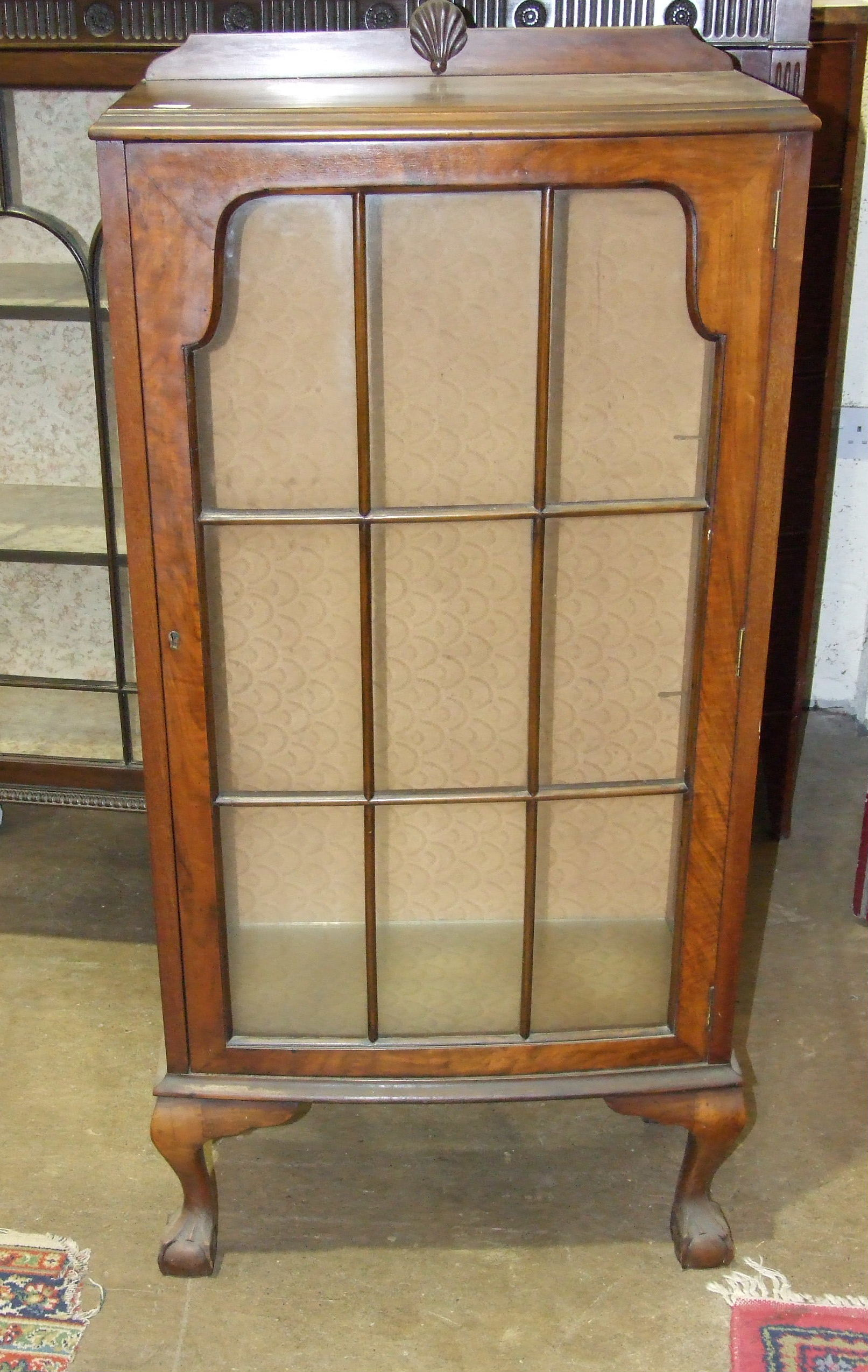 Lot 3 - A mahogany display cabinet the rectangular top above a pair of astragal glazed doors on square