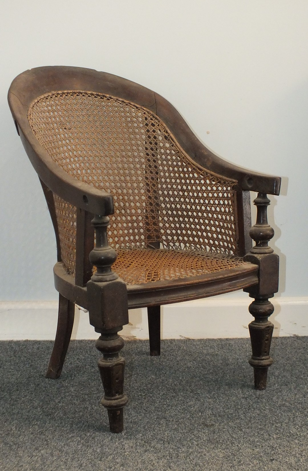Lot 33 - A Victorian child's bergere chair on turned legs (metal strengthening bracket), a basket planter