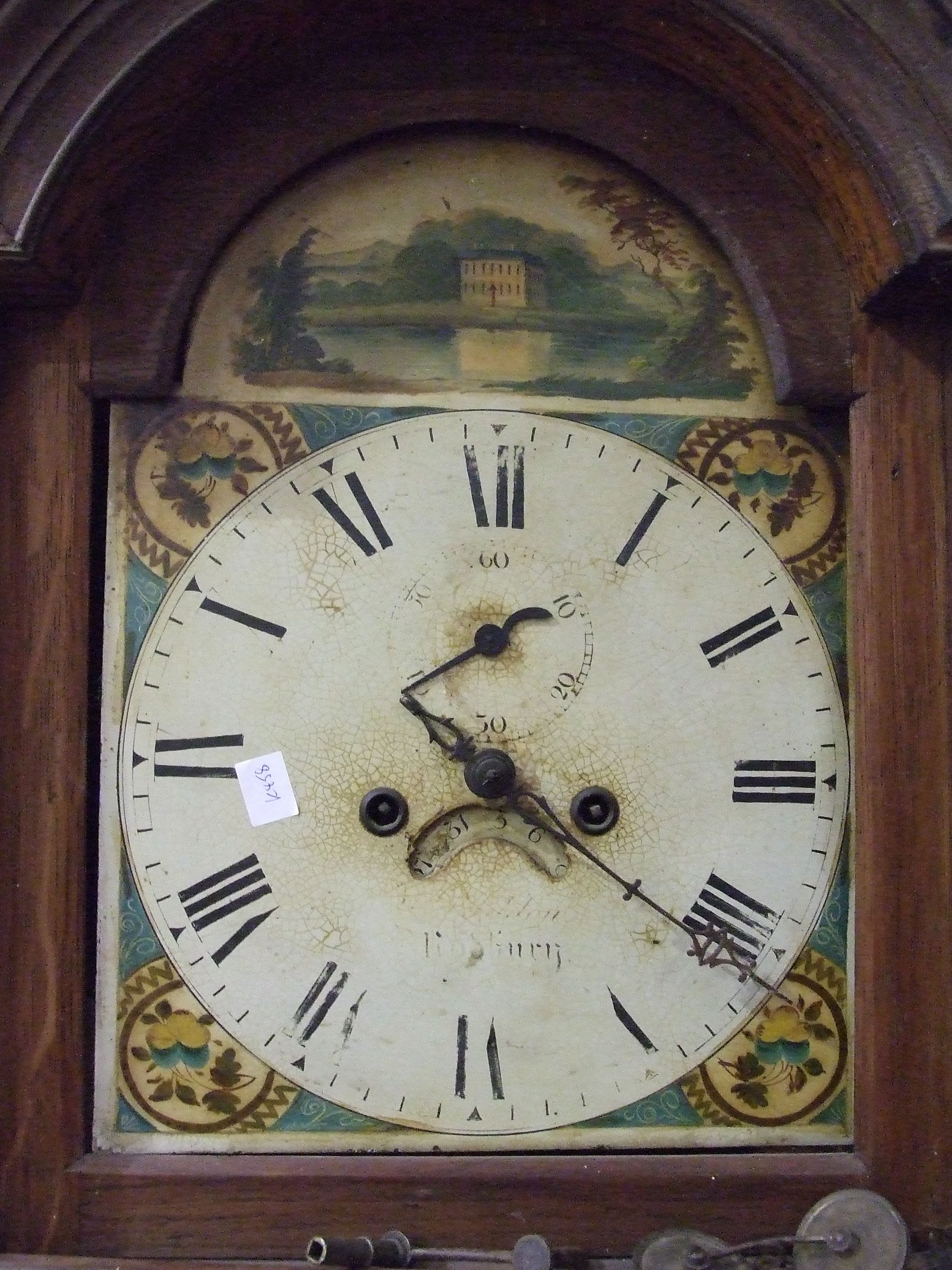 Lot 15 - An early 19th century oak longcase clock with arched painted dial and twin-train bell-striking