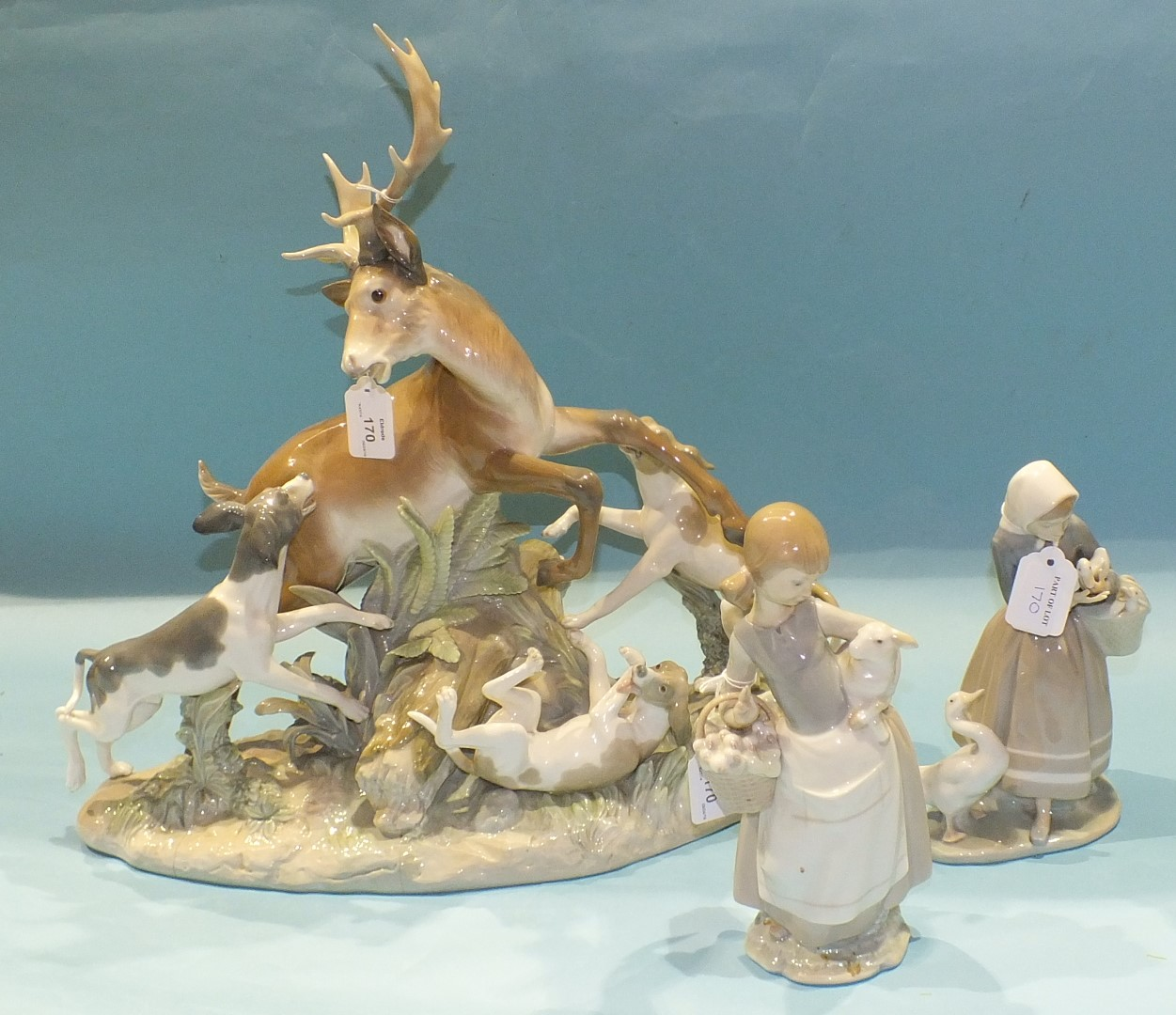 Lot 170 - A Lladro animal group, Buck Hunters, 48cm high, 50cm wide, (af, three cracks across the base,