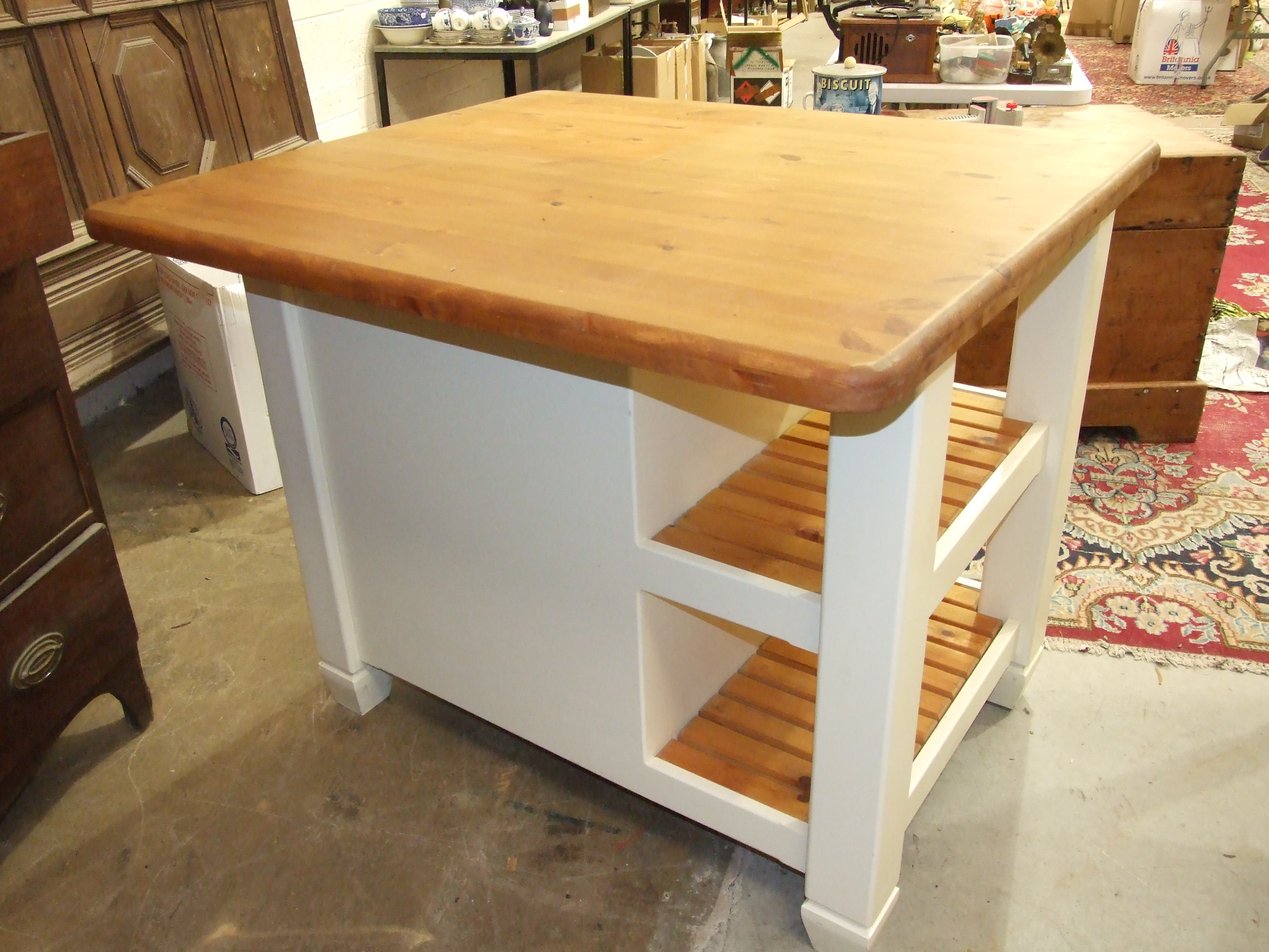 Lot 9 - A modern pine and painted wood kitchen island, 110 x 84cm, 94cm high.