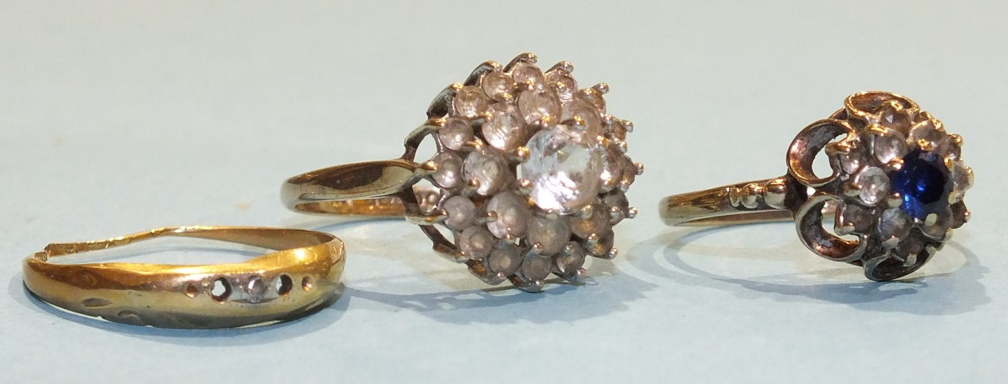 Lot 199 - Two 9ct gold gem set cluster rings, sizes O and P, 5.6g and an 18ct gold ring (af), 1g.